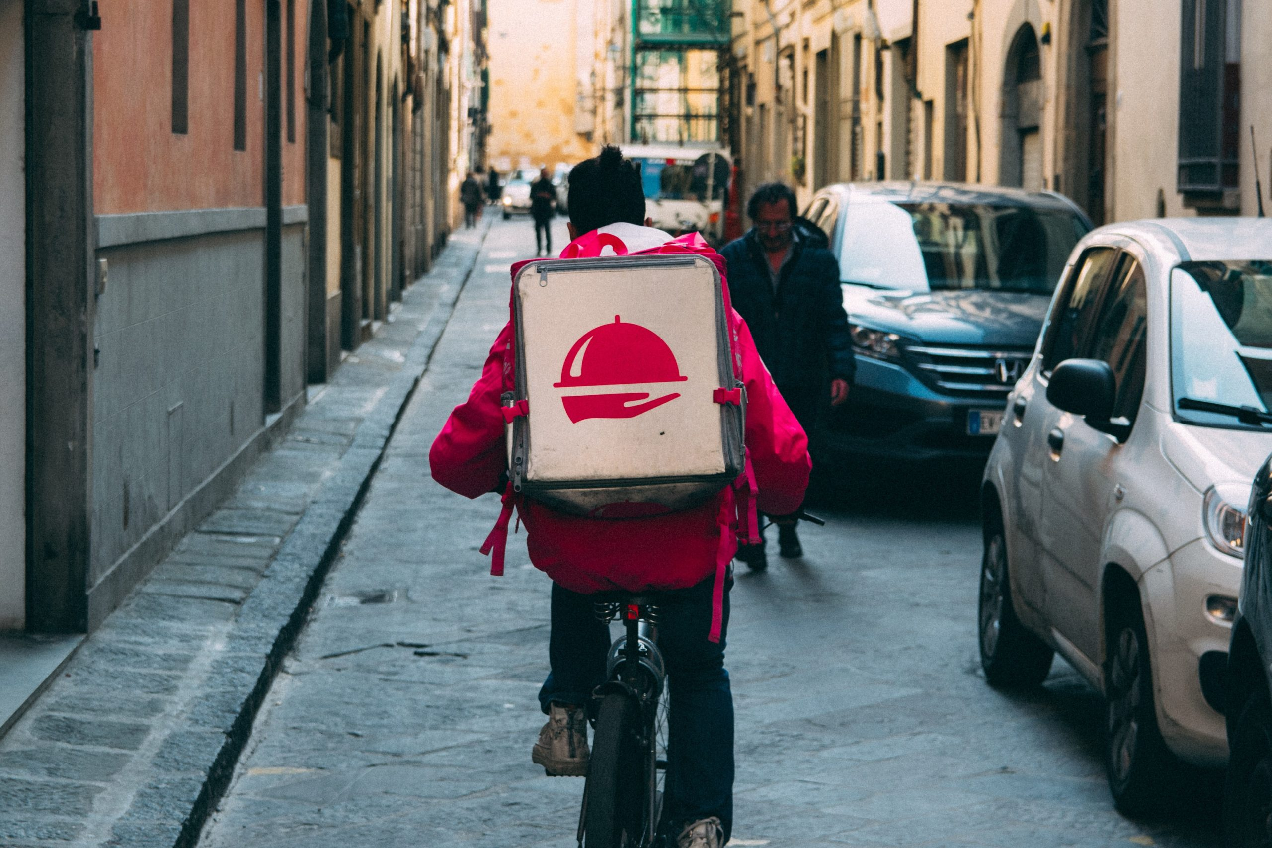 delivery box carried by a man on bicycle
